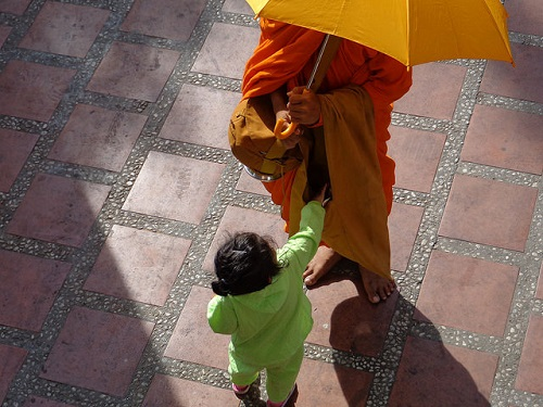 Monk and child in Cambodia - Amy McPherson