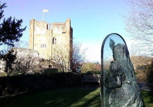 Alice Through The Looking Glass sculpture by the castle.