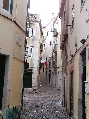 Exploring the narrow lane ways of Alfama district is a good way to get a feel of local life.