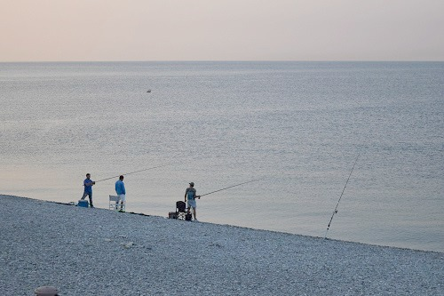 Fishermen on Nice beach at dusk (Photo: William McPherson)